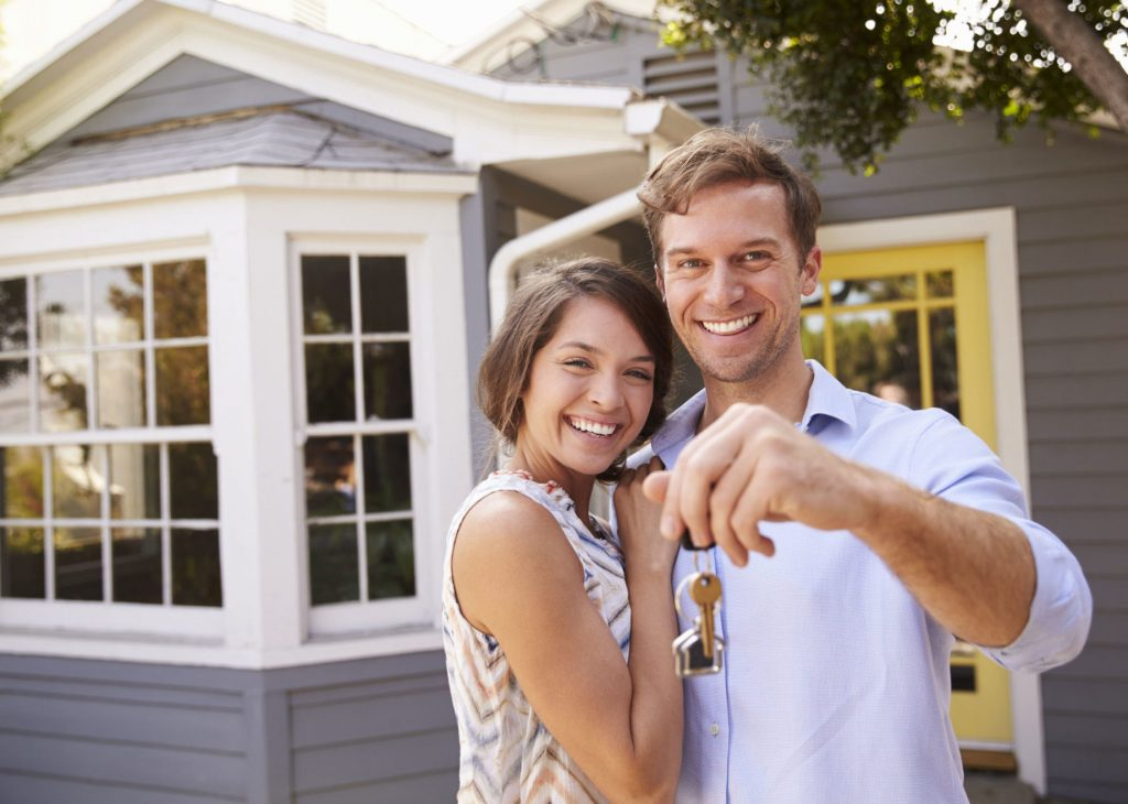 Image of a couple with a new property